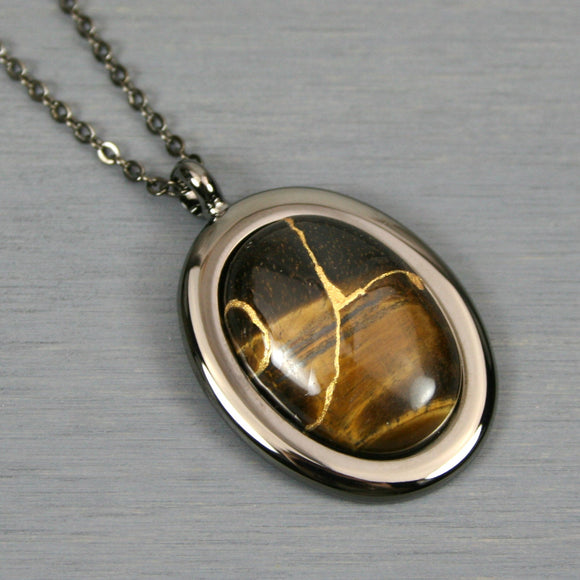 Tiger eye kintsugi pendant in a gunmetal setting on chain from A Kintsugi Life