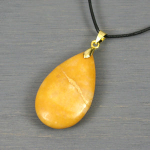 Golden yellow stone teardrop pendant with kintsugi repair on black cotton cord from A Kintsugi Life