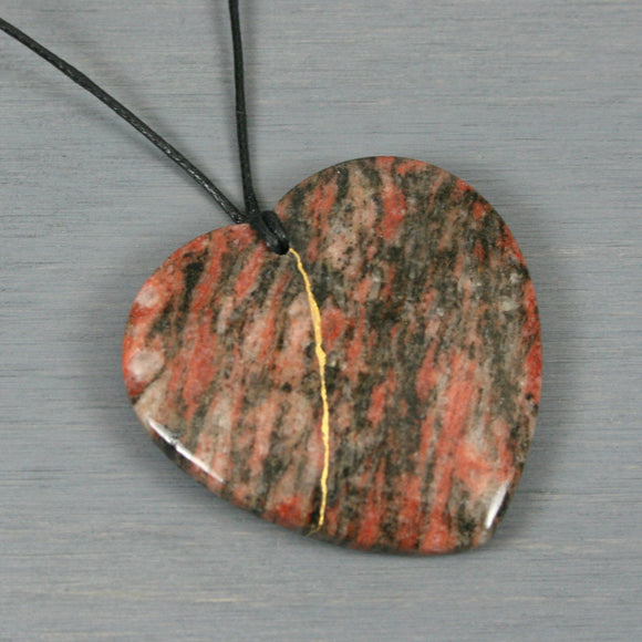 Red and black striped jasper heart pendant with kintsugi repair on black cotton cord from A Kintsugi Life