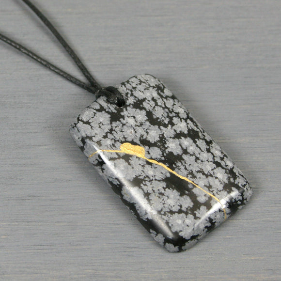 Snowflake obsidian pendant with kintsugi repair on black cotton cord from A Kintsugi Life