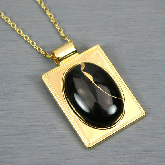 Black onyx kintsugi pendant in a gold setting on chain from A Kintsugi Life