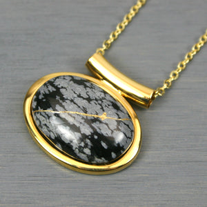 Snowflake obsidian kintsugi pendant in a gold setting on chain from A Kintsugi Life