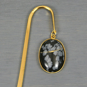 Snowflake obsidian with kintsugi repair on gold plated steel bookmark from A Kintsugi Life