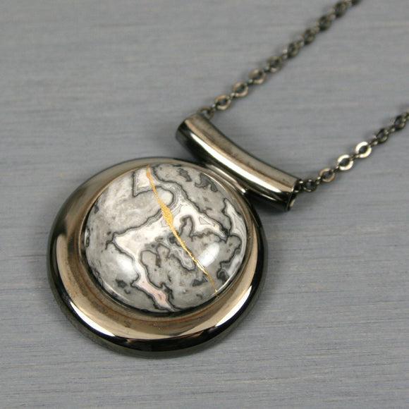 Black lace agate kintsugi pendant in a gunmetal setting on chain from A Kintsugi Life