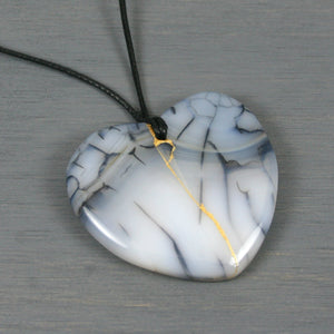 White and black dragon veins agate broken heart pendant with kintsugi repair on black cotton cord from A Kintsugi Life