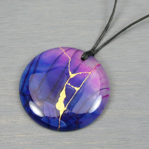 Blue and purple dragon veins agate pendant with kintsugi repair on black cotton cord from A Kintsugi Life