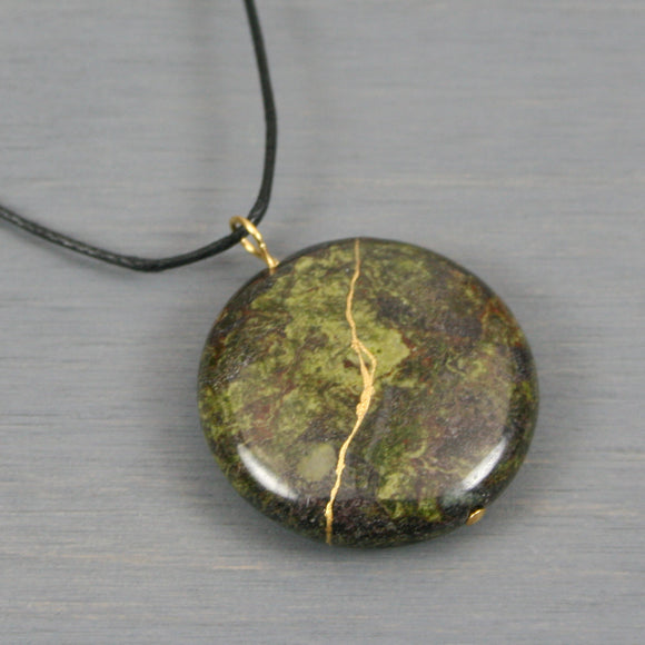Dragon blood jasper pendant with kintsugi repair on black cotton cord from A Kintsugi Life