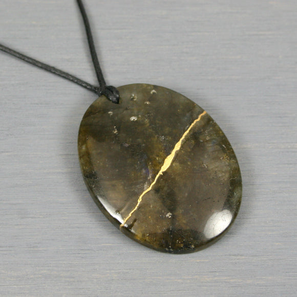 Labradorite pendant with kintsugi repair on black cotton cord from A Kintsugi Life