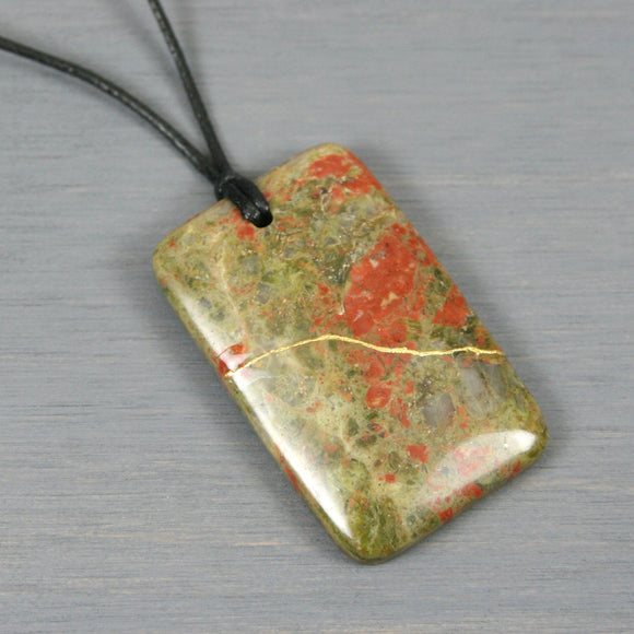 Unakite pendant with kintsugi repair on black cotton cord from A Kintsugi Life