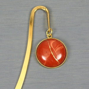Red jasper with kintsugi repair on gold plated steel bookmark from A Kintsugi Life