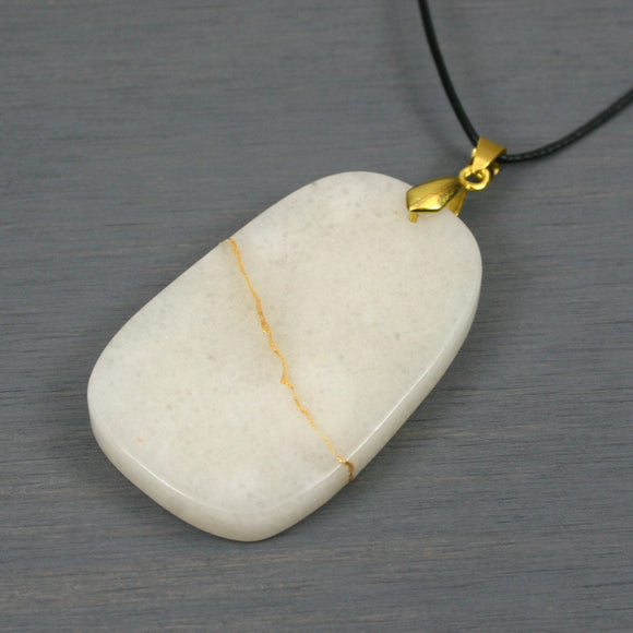 Snow quartz pendant with kintsugi repair on black cotton cord from A Kintsugi Life