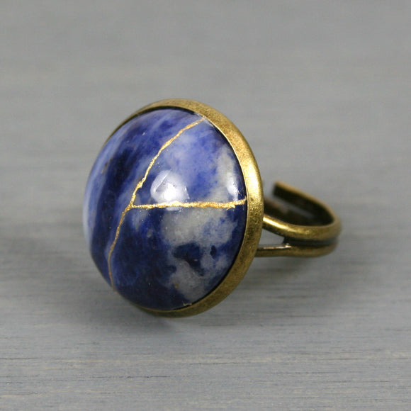 Sodalite kintsugi ring in an antiqued brass adjustable setting from A Kintsugi Life