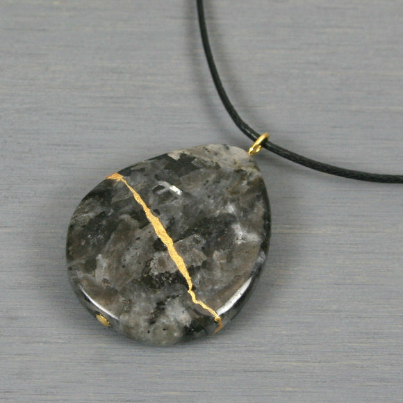 Larvikite (or blue labradorite) pendant with kintsugi repair on black cotton cord from A Kintsugi Life
