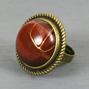 Red tiger eye kintsugi ring in an antiqued brass adjustable setting from A Kintsugi Life