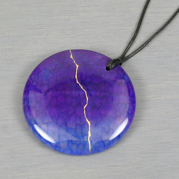 Purple and blue dragon veins agate pendant with kintsugi repair on black cotton cord from A Kintsugi Life