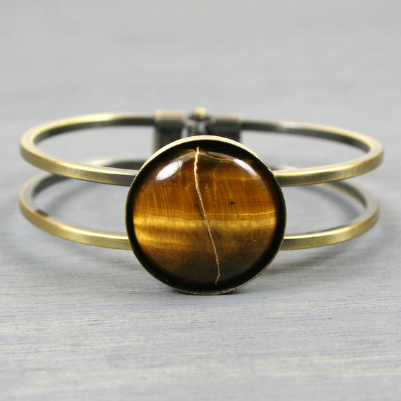 Tiger eye kintsugi bracelet in an antiqued brass hinged bangle setting from A Kintsugi Life