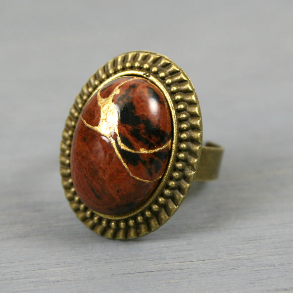 Mahogany obsidian kintsugi ring in an antiqued brass adjustable setting from A Kintsugi Life