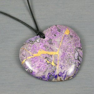 Lavender crazy lace agate broken heart pendant with kintsugi repair on black cotton cord from A Kintsugi Life