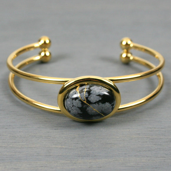 Snowflake obsidian kintsugi bracelet in a gold cuff setting from A Kintsugi Life