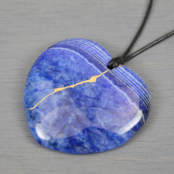Blue dragon veins agate broken heart pendant with kintsugi repair on black cotton cord from A Kintsugi Life