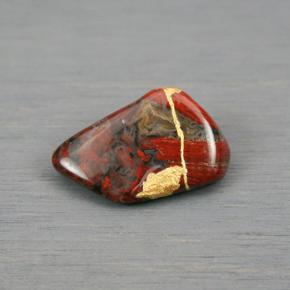 Small kintsugi repaired starry jasper tumbled stone from A Kintsugi Life
