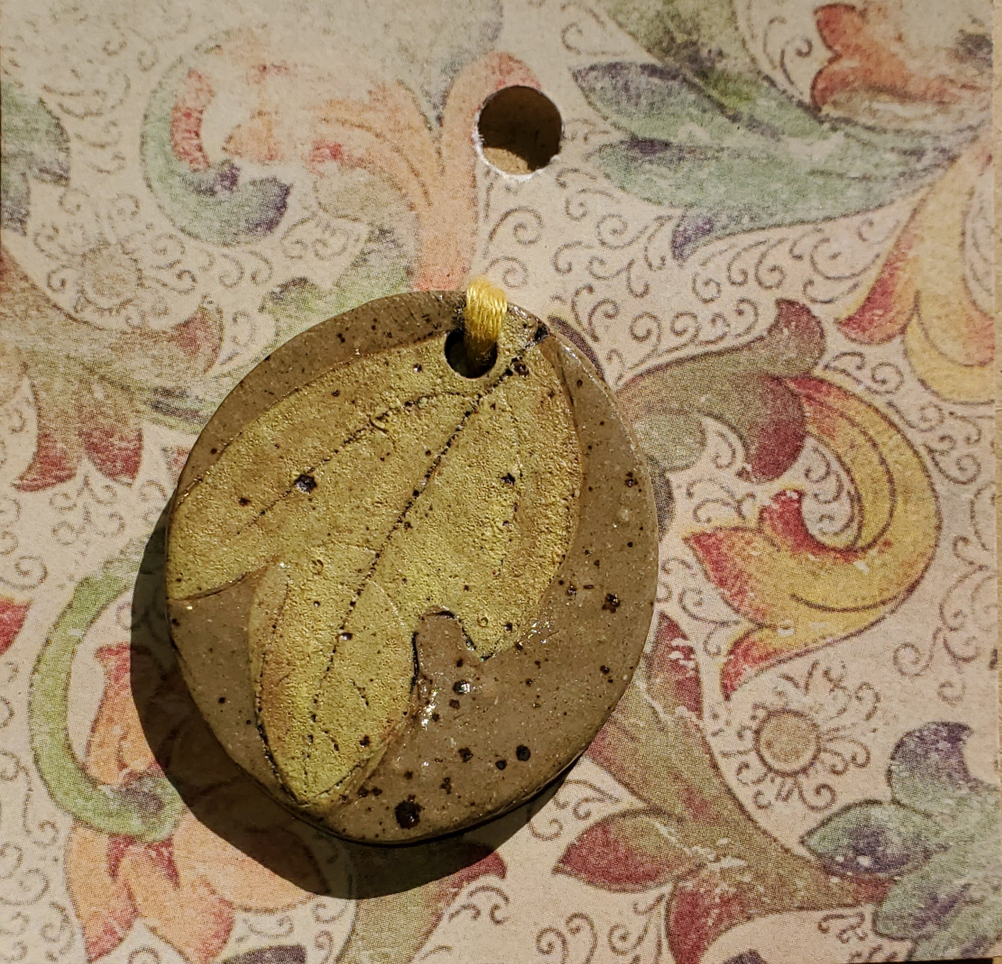 Leaf imprint clay pendant by Annette keese