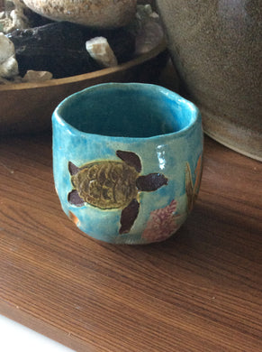 Hand built ceramic sea turtle small cup byLaurel Herbert