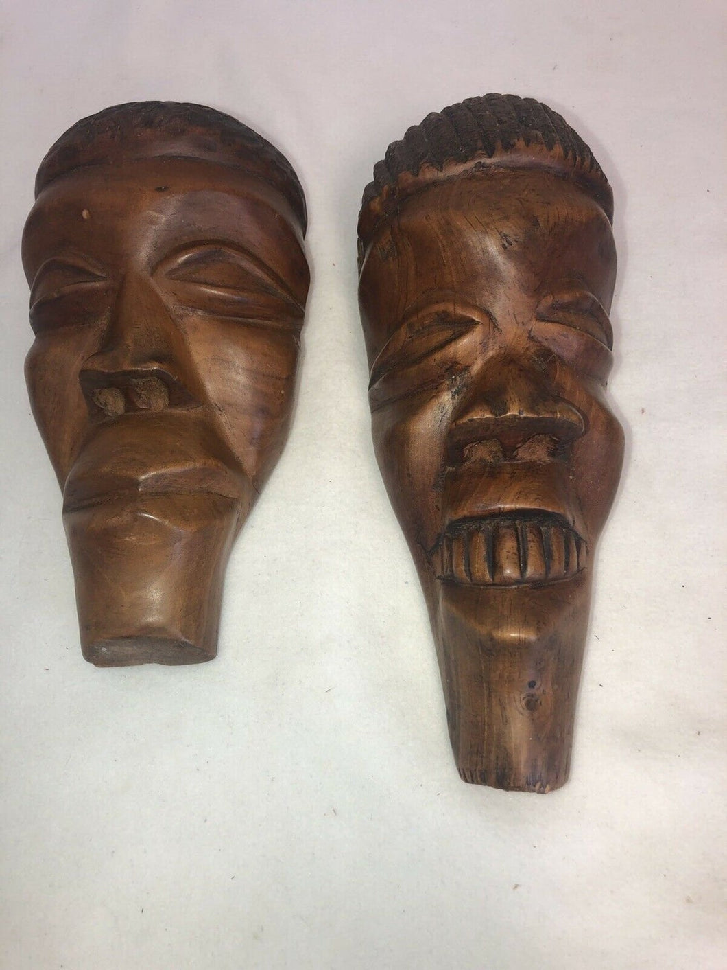 "A Pair Of Hand Carved Unattributed African Hard Wood Male & Female 10.5"" Faces"
