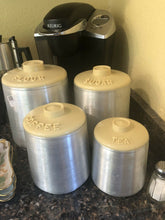 Load image into Gallery viewer, Kromex 1950's vintage aluminum canister set of 4 Yellow Lids Nice Condition Retro