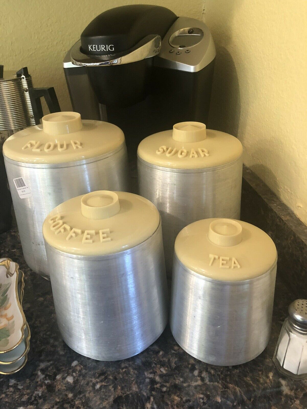 Kromex 1950's vintage aluminum canister set of 4 Yellow Lids Nice Condition Retro