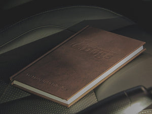 Noteworthy Dogs Notebook showing the dembossed logo on the PU Leather Cover