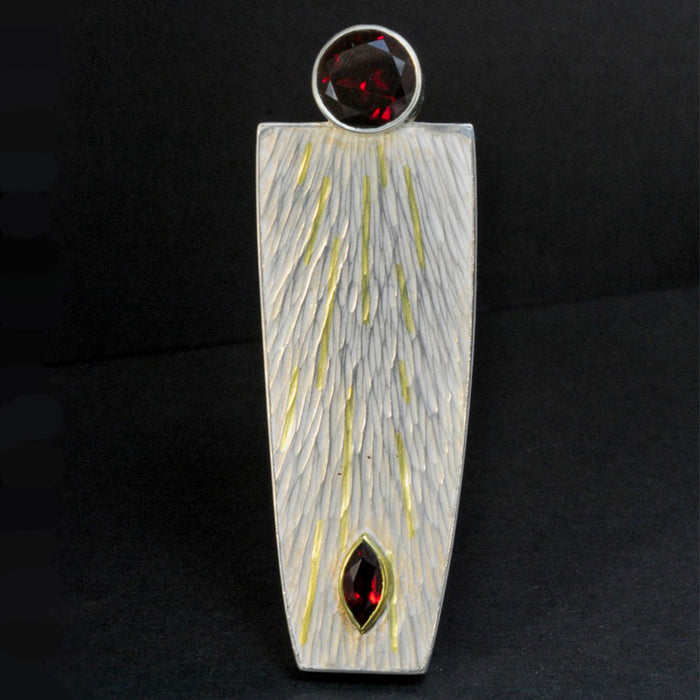 Silver and 18ct Gold Brooch with Garnet