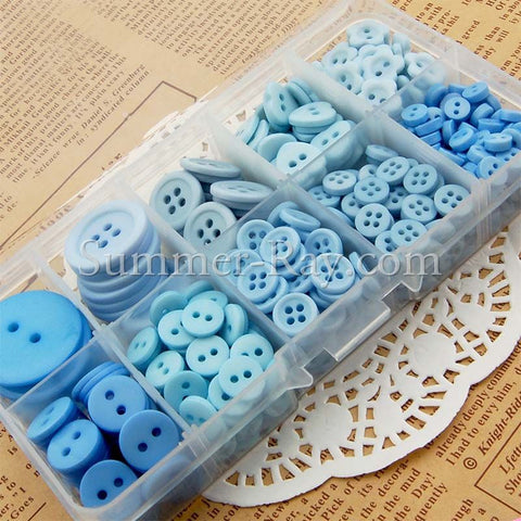 Mixed Size Blue Doll Buttons in Storage Box