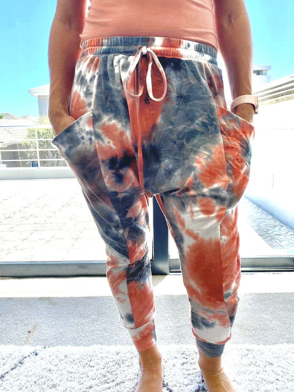Freda and Dick track pants - Tie dye orange