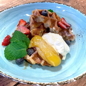 Belgium Waffles  w. lemon curd, fresh cream, fresh fruits and mint topped with maple syrups