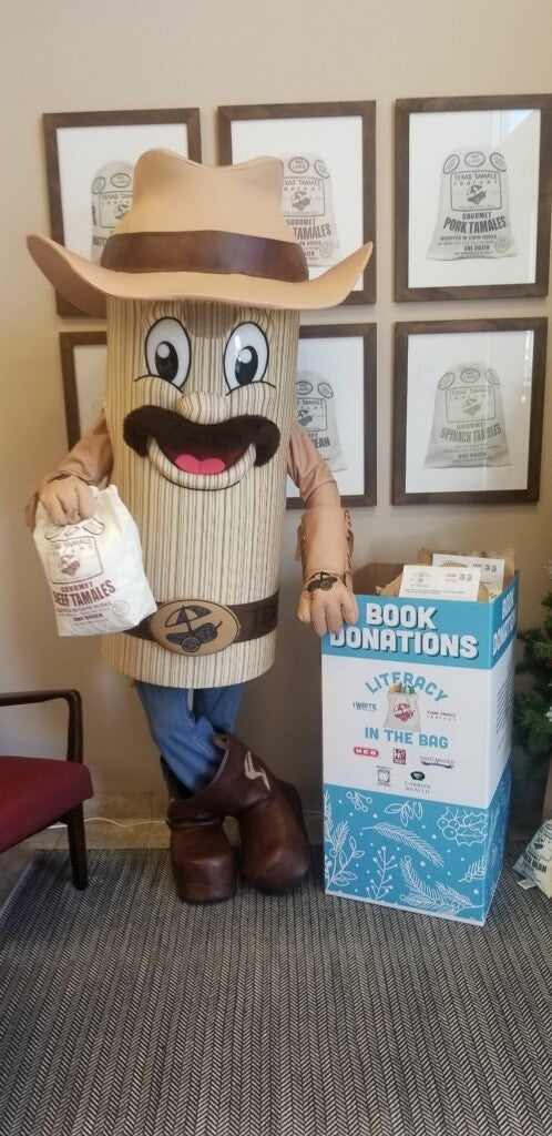 Tommy Tamale supporting local literacy with Literacy in the Bag