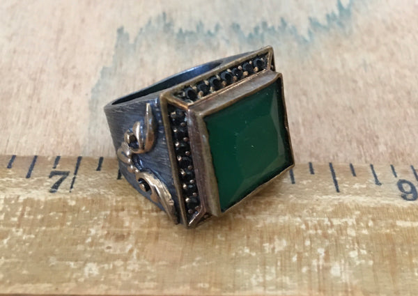 Sterling ring with tiny Black spinel and emerald centerpiece
