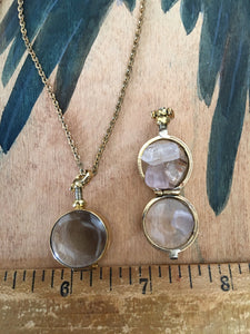 Small wide round brass lockets