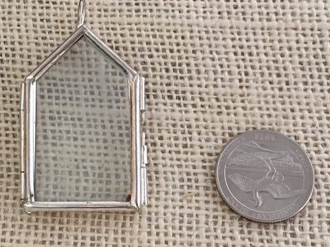 House shaped silver locket
