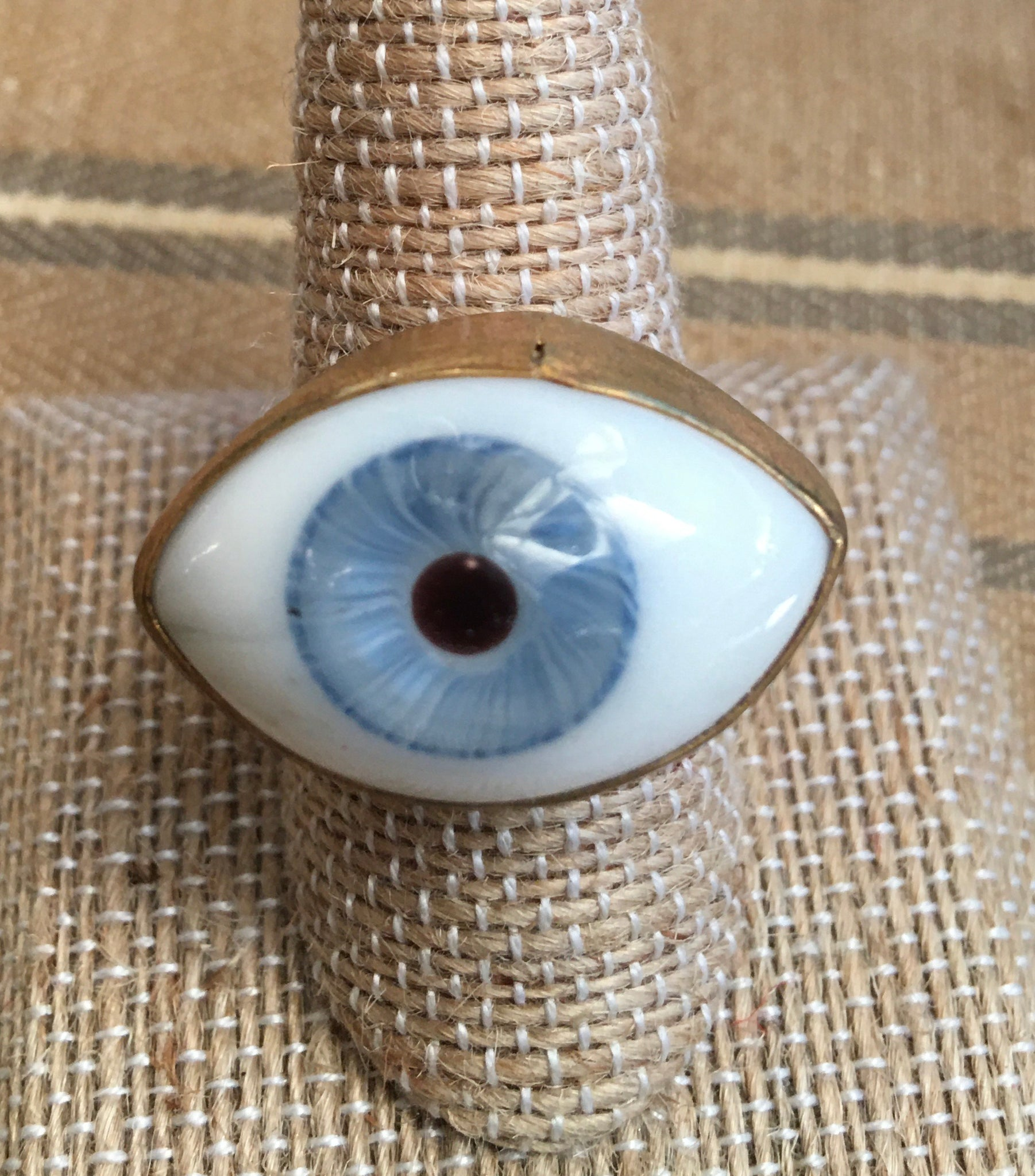 Size 9 hand-blown glass green eye ring set in brass