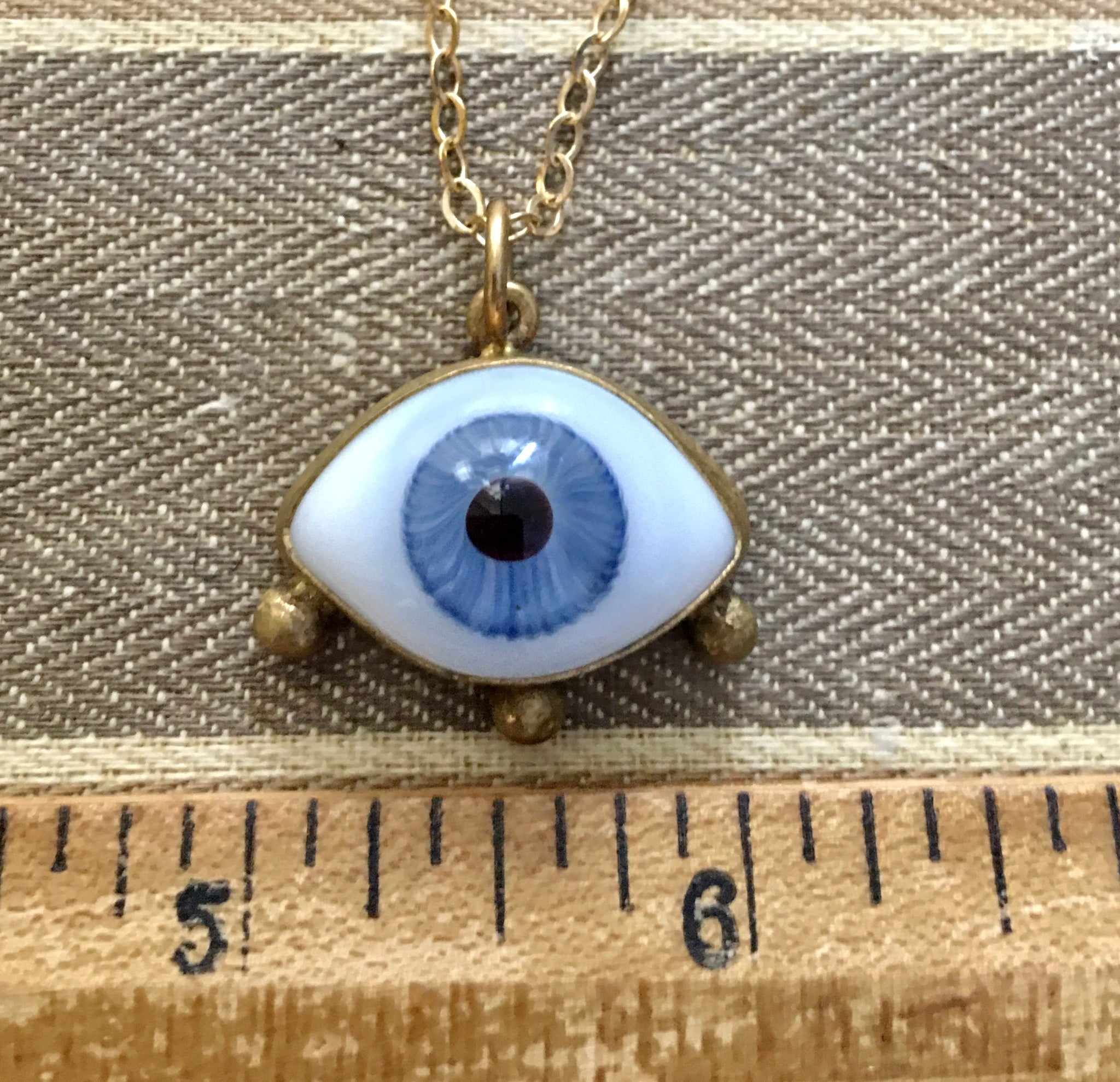 "Blue eye charm with lashes on a 16"" brass chain"