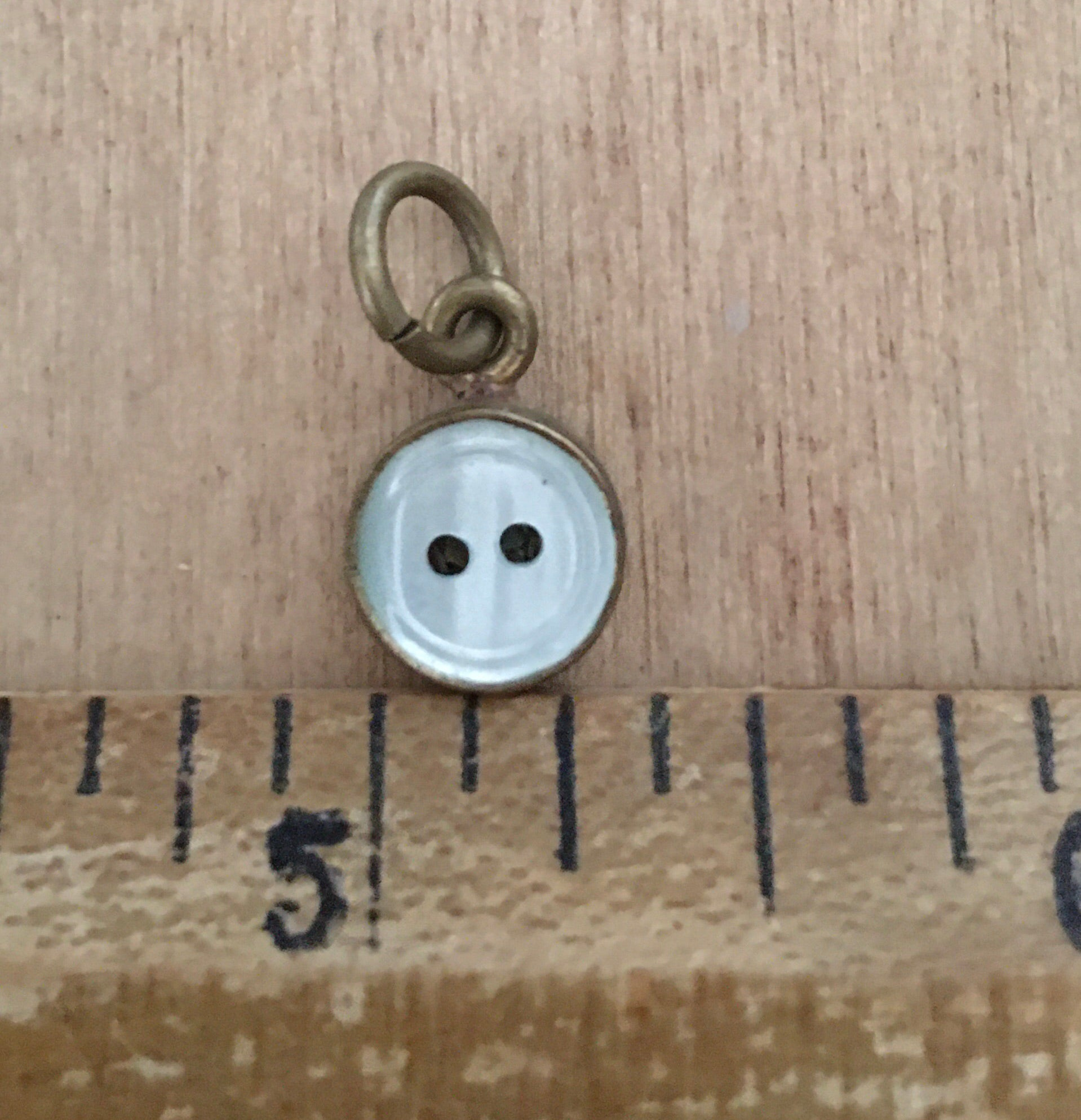 Tiny button charm