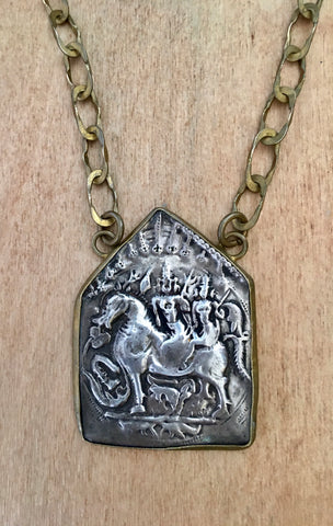 Tribal sterling horse amulet set in brass