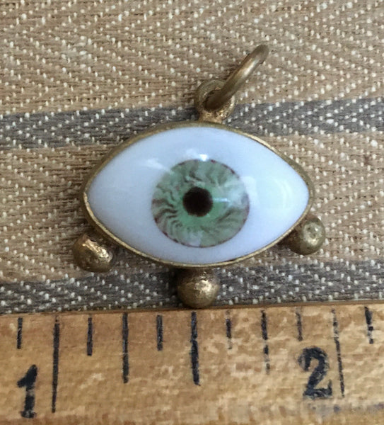 Brass medium green eye with stud lashes