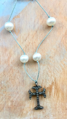 Delicate diamond cross on pearls