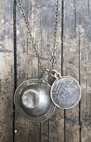 Tribal shield and Arabic coin necklace