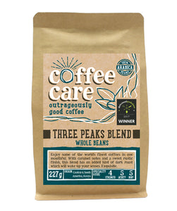 A 227g kraft packet of Coffee Care's Three Peaks Coffee Beans. Blue label for whole beans. Freshly roasted Kenya, Central & South America Coffee. 100% Arabica. Delicuouslyorkshire Winner 2017