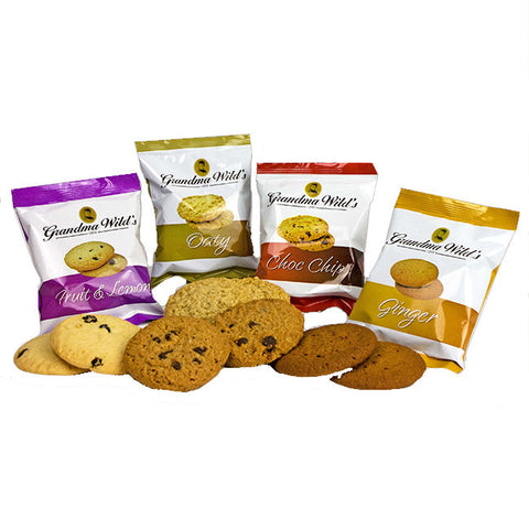A selection of 4 twin pack of Grandma Wilds biscuits. Fruit & Lemon, Oaty, Choc Chip, Ginger. With display of biscuits in front