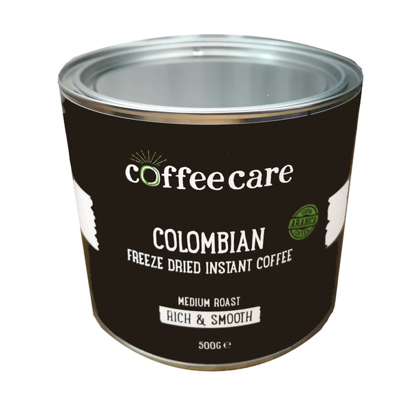 Higher view showing the lid to a metal tin of Coffee Care's Colombian Freeze Dried Instant Coffee. 500g of arabica coffee. Medium roast, rich and smooth