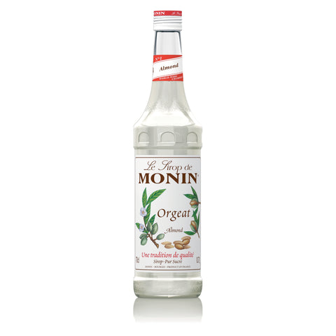 A 70cl glass bottle of MONIN Almond (Orgeat) syrup.